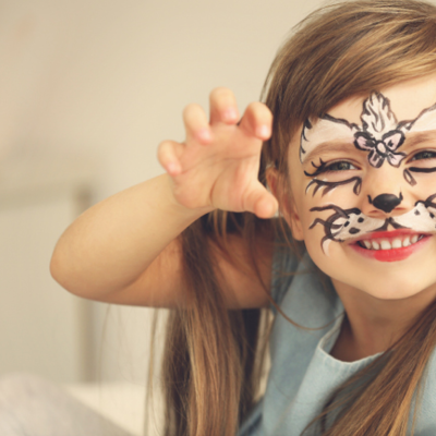 A child smiling with face paint on